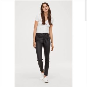 H&M black coated skinny jeans- size 10
